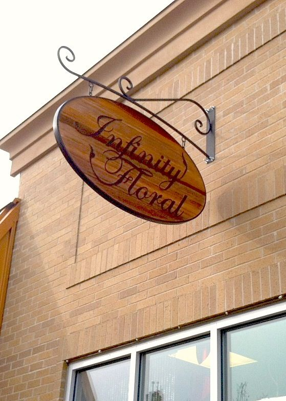 Natural Wood And Metal Blade Sign Fits In Nicely At A Local Retail