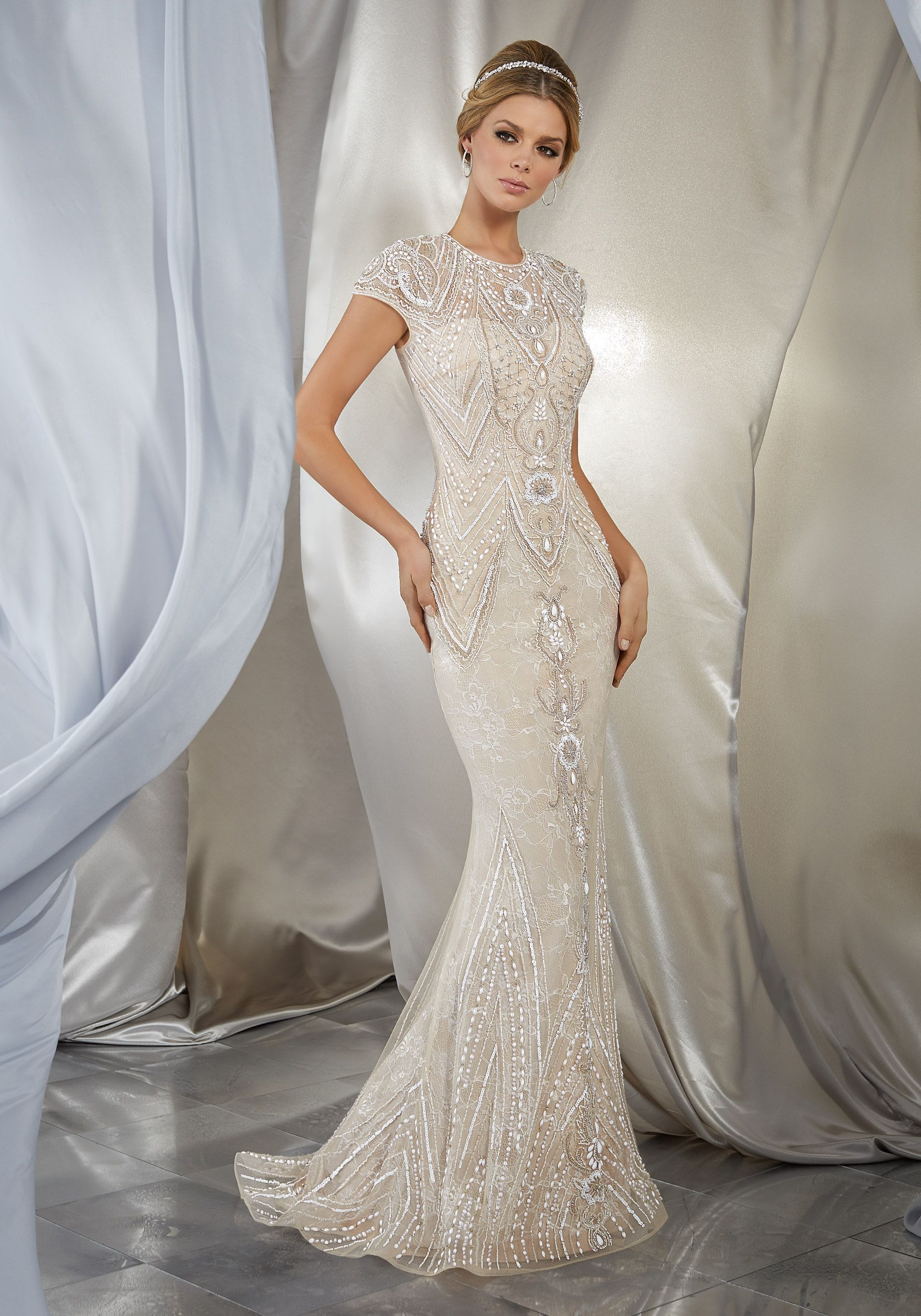 Intricate beadwork creates a glamorous look on this slim tulle gown