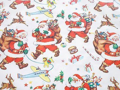 vtg christmas wrapping paper gift wrap post ww2 santa toys airplane benmont