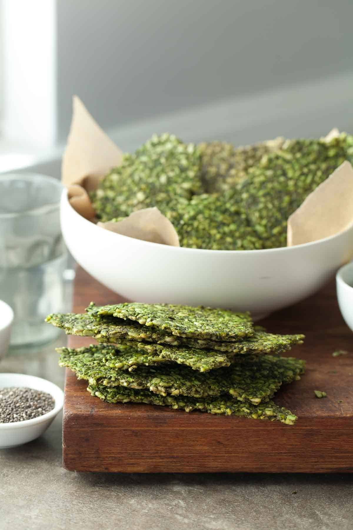 Gluten Free Pesto Kale Seed Crackers Paleo Vegan Recipe In 2020 Healthy Snacks Recipes Gluten Free Pesto Healthy Vegan Snacks