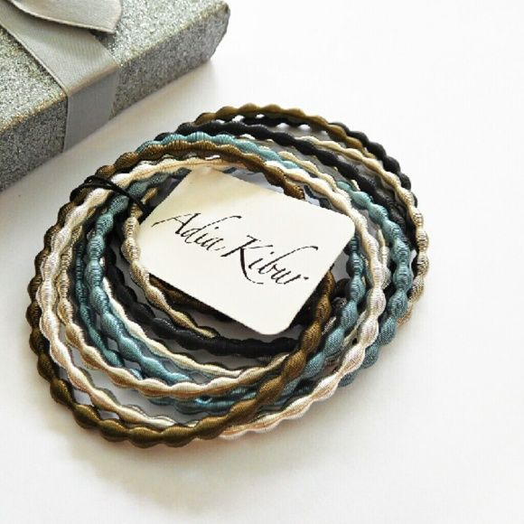 Stacking Bangle Set Stretchy metallic bangles in five colors.  Set of ten: 2 steel blue, 2 shiny black, 2 silver,, 2 copper and 2 shiny silver.  Designed in the USA. Adia Kibur Jewelry Bracelets