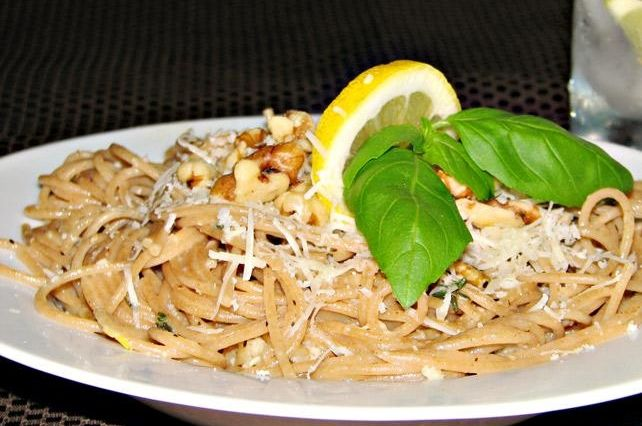 Whole grain lemon spaghetti blends the lightness of citrus and the richness of whole grain and nuts.  The pairing is a wonderful healthy product filled with incredible flavor and nutrition.  This dish is perfect for an entre' or as a complimentary side to fish, chicken and even beef or lamb.  You will be smitten at first bite, rushing to put this in your favorites file to be served at your table over and over again.
