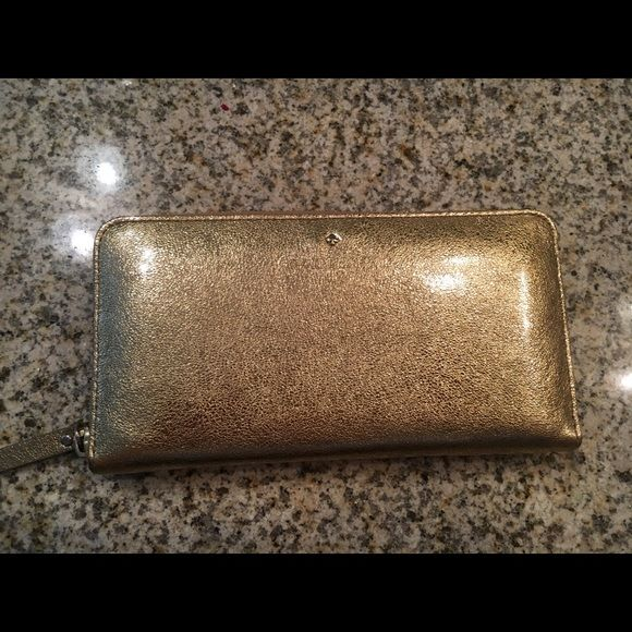 Gold Kate Spade wallet Authentic Kate Spade wallet. Super cute, super fun. Used twice. Really pretty gold color. Trade value $250 kate spade Bags Wallets