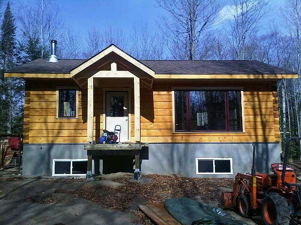 A Small And Practical Log Home Cool House Designs Small Home Plan Log Cabin Plans