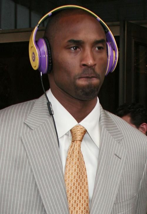 On His Way To Work With The Lakers Colors Beats Head Phones Go Lakers Beats By Dre Beats By Dr Dre Dr Dre