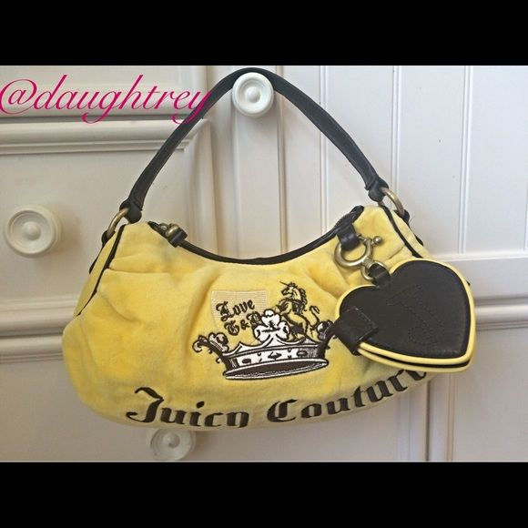 "Juicy Couture Handbag Host Pick 9/11 This little bag is sure to brighten your day. Canary yellow with gorgeous dark brown leather trim. 12"" wide,  7"" high and 3"" thick. Has one zippered pocket in the inside plus a key fob. Mirror on the outside still has protective covering on it. New without tags. Juicy Couture Bags"