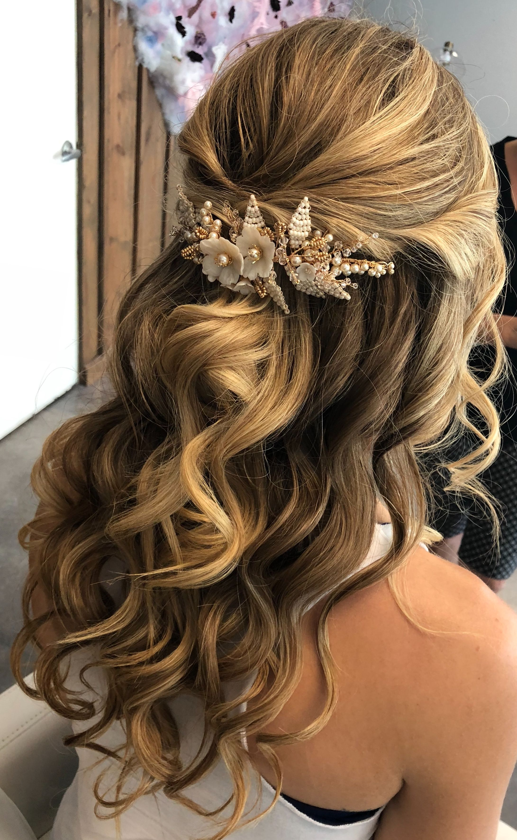 half up half down bridal hair style with hair accessory from