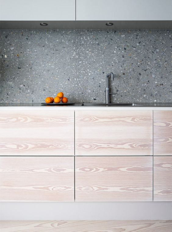 grey terrazzo kitchen backsplash contrasts the light colored