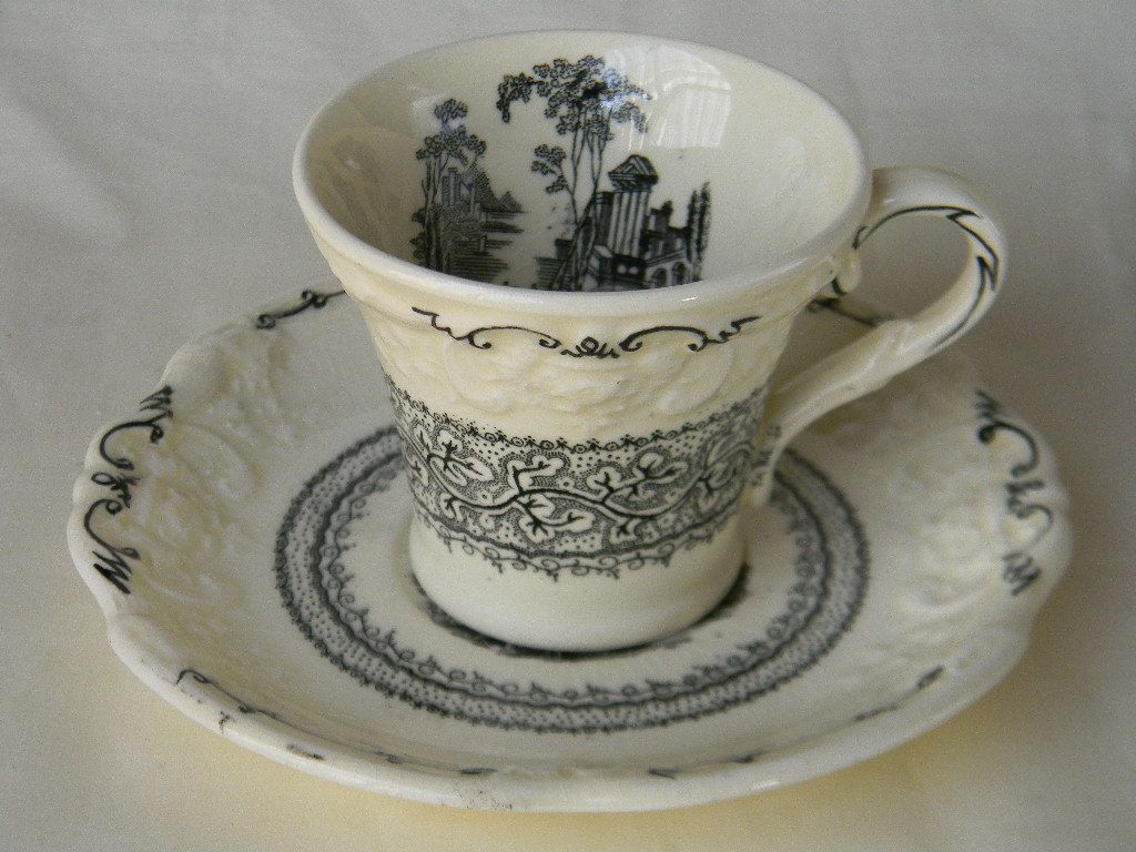 Antique  Black English Transferware Demitasse Cup and Saucer  Genoa Embossed Floral Border. $29.99, via Etsy.
