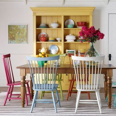 Yellow hutch chairs painted different colors kitchen for Different color chairs