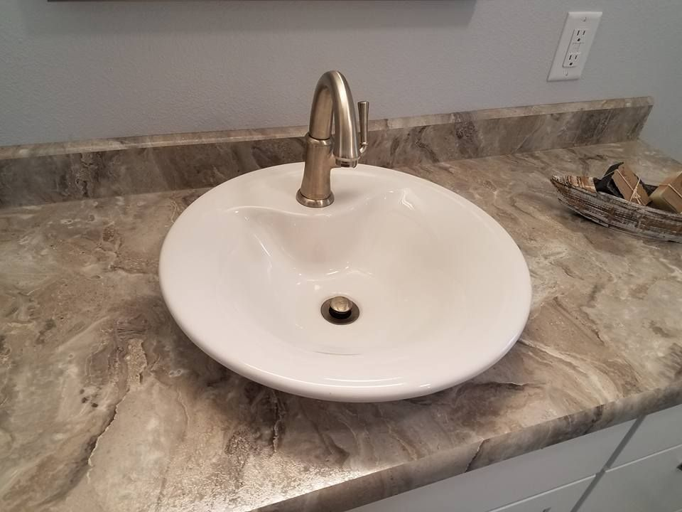 Cipollino Bianco Laminate Countertop With A Top Mount Vessel Sink