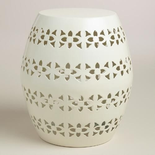 Decorated with a punched floral design, our stool is an eclectic seating solution for the patio or porch that also doubles as an accent table.