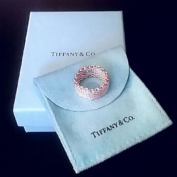 """TIFFANY & CO Somerset Mesh Ring TIFFANY & CO Somerset Mesh Ring  -  A Tiffany classic!  - 100% Authentic   - Excellent condition!   - Sterling Silver  - Comes with pouch & box as shown  - Approximately size 5 1/2... slightly stretches  - """"Mesh"""" like look Tiffany & Co. Jewelry Rings"""