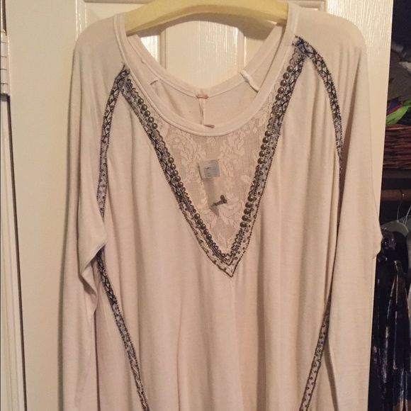 Free People Sweater Dress (Tag still on) Beige beaded V sweater dress. Could also be a long top for a tall girl like me! Very cute never worn with the tag still on Free People Dresses Long Sleeve
