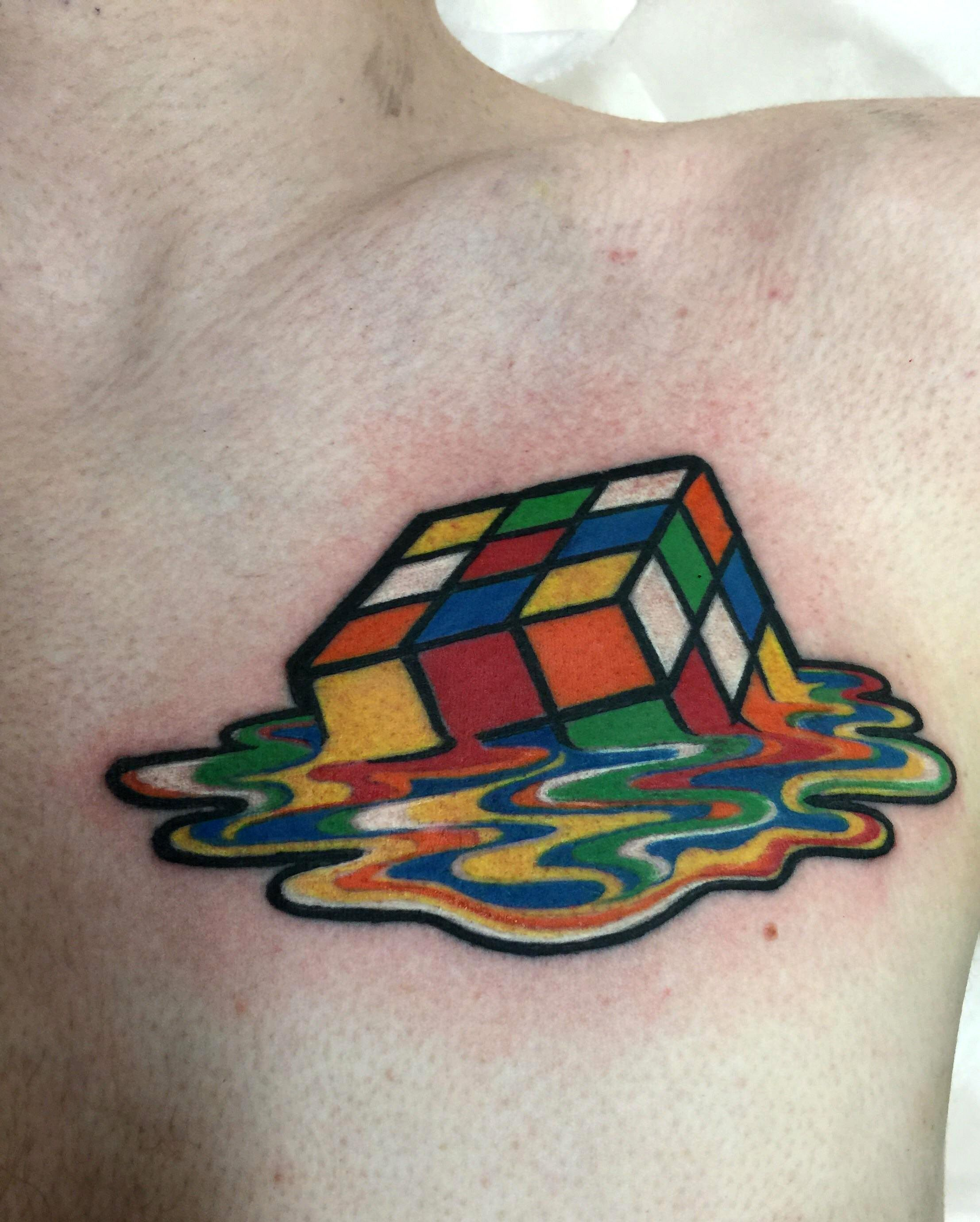 Melting rubiks cube tattoo by laetitia at angel tattoos in