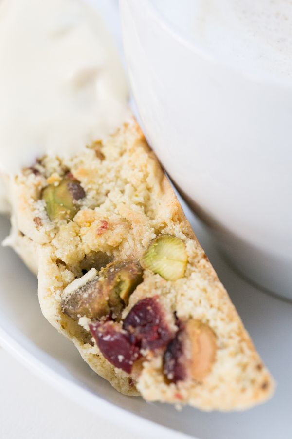 The BEST Holiday Biscotti with cranberries, pistachios, vanilla and lemon dipped in white chocolate!