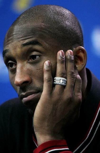 Kobe Bryant shows his diamond studded wedding ring The A List