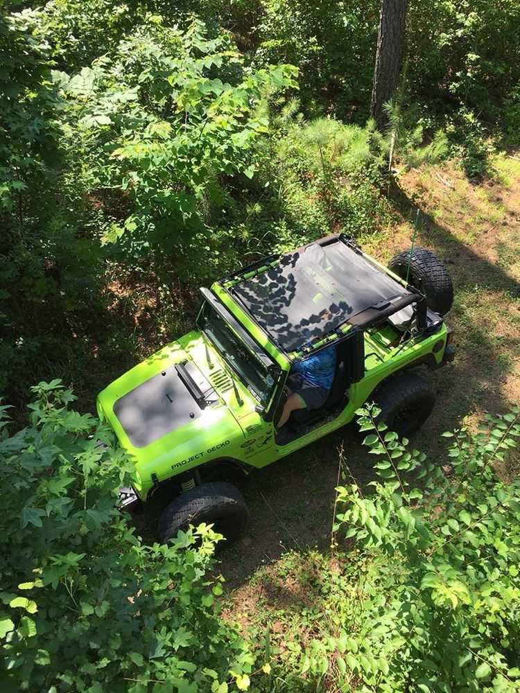 3178e4d3d06 Just out explorin' Front to rear Sunshade for the 2 Door Jeep Wrangler JK.  Our sunshade mesh tops install in minutes and give you that unbeatable ...