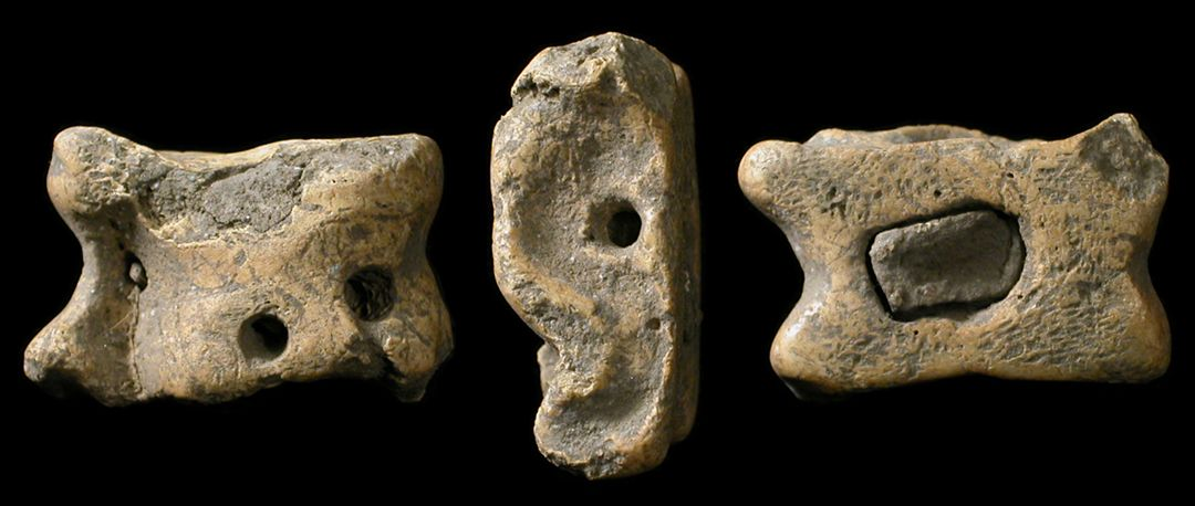 "Ancient Greece, 5th-3rd century BC. The earliest dice! Made from the knuckle-bone of an animal, drilled and filled with lead for weighting. These were thrown like modern dice, and each side bore a different significance. 29 mm (1 1/8"") long. Found in former Thrace-Macedonia. ex-UK collection. #AR2080"
