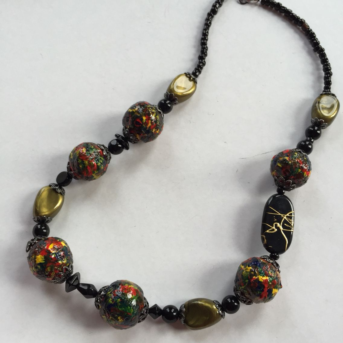 #jewelry #necklace #beads made from #newspaper @nytimes #glue #resin #handmade #handcrafted #upcycled #recycled #material #multicolor #unique #art #craft #hand #painted