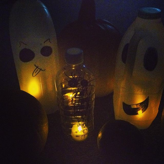 Spooky!!! Megan, Olive and I made ghost lanterns from milk jugs, black markers and led lights, nestled in our pumpkins on the window they look frightful!! #halloween #recycle #lights #ghosts #pumpkin #homeinterior
