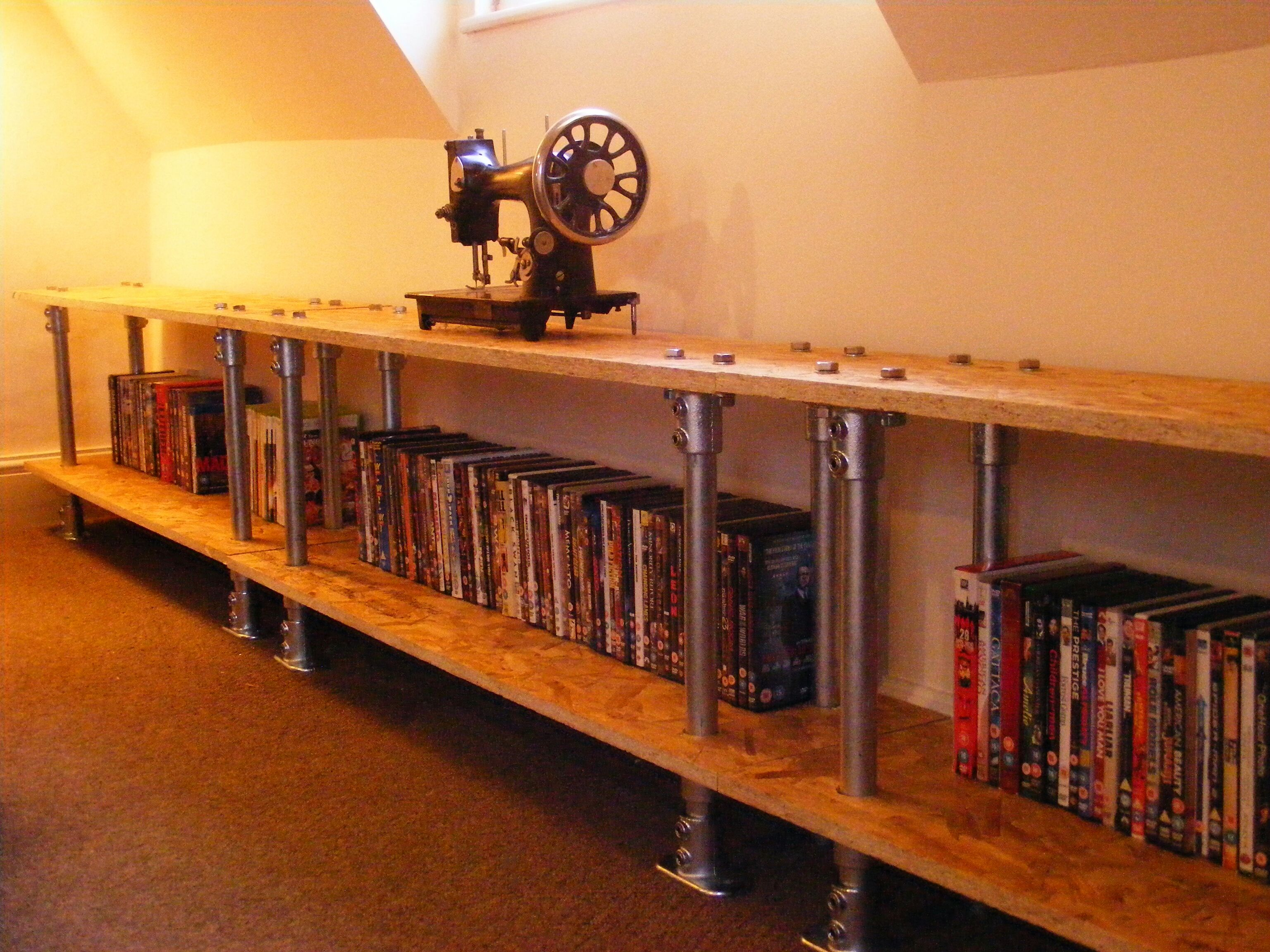 I designed and created some galvanised pipe with OSB shelving and