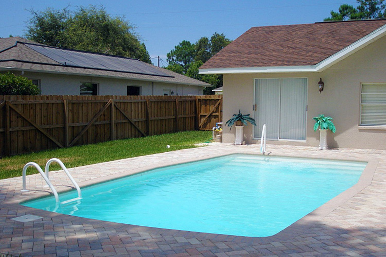 Volleyball pool designs ground fiberglass pool by aloha for Fiberglass pool manufacturers