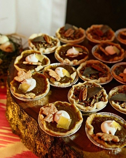 Mini pecan pies (a favorite Southern staple) were set up on the dessert table and topped with mini leaf-shaped pie crusts and whipped cream. Instead of a traditional groom's cake, the groom opted for mini pumpkin pies.