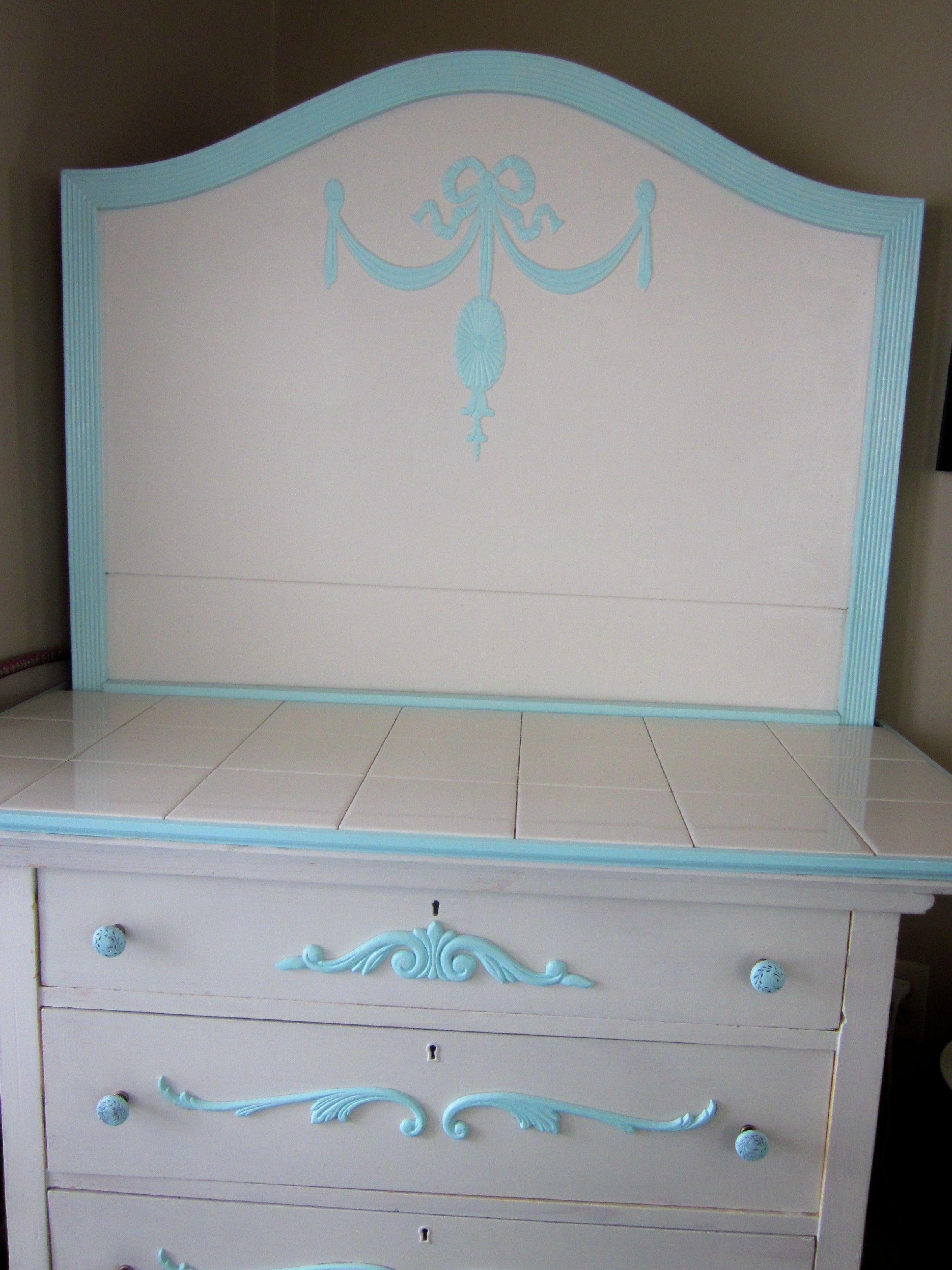 Take one old dresser and a broken vintage headboard Add new pressed