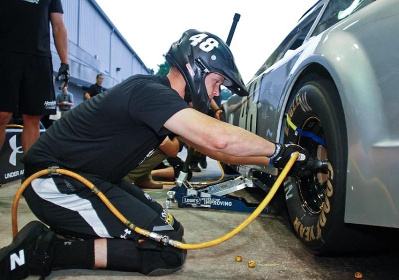 A Tire Changer Has One Of The Most Critical Jobs On Pit Road Because A Loose Lug Nut Can Be Costly Nell Redmond Sporti Nascar American Sports Nascar Drivers