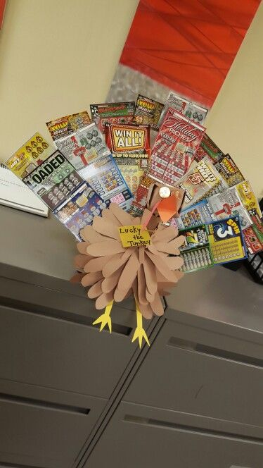 lucky the lotto ticket turkey made for a holiday gift basket raffle using styrofoam ball for the base construction paper lotto tickets for tail feathers