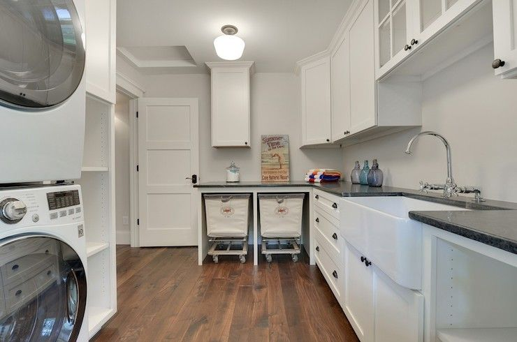 Fabulous Laundry Room Features White Shaker Cabinets Paired With