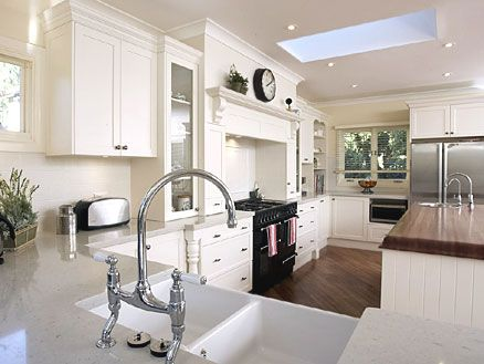 French Country Kitchen Design   White Cabinets In Combination With Stone  Counters, Porcelain Sink And