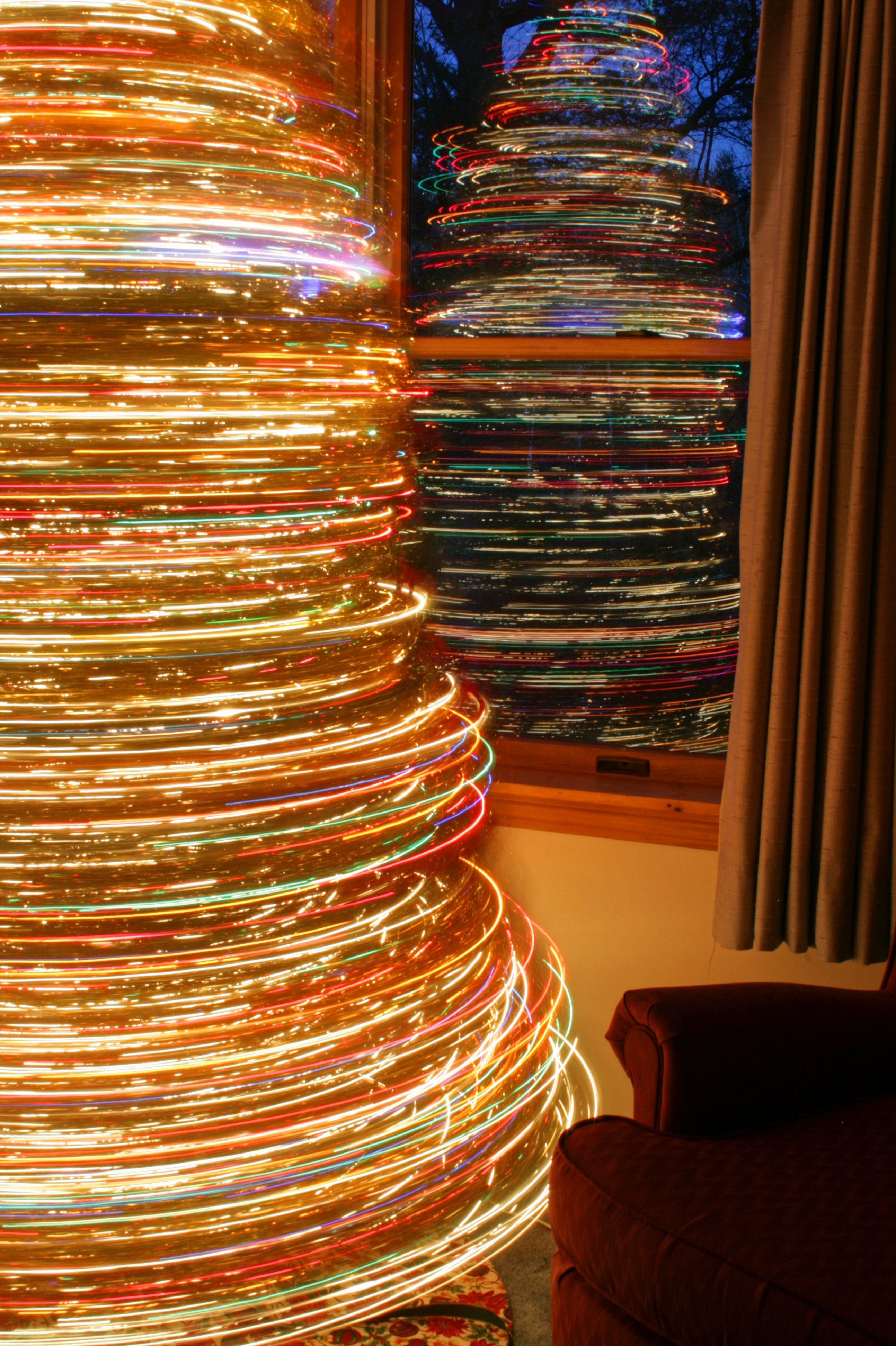 Long exposure plus rotating Christmas tree = cool light trails
