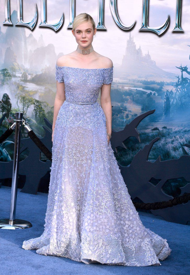Pin for Later: Angelina Jolie and Brad Pitt Make Maleficent a Family Affair  Elle Fanning looked glamorous in purple.