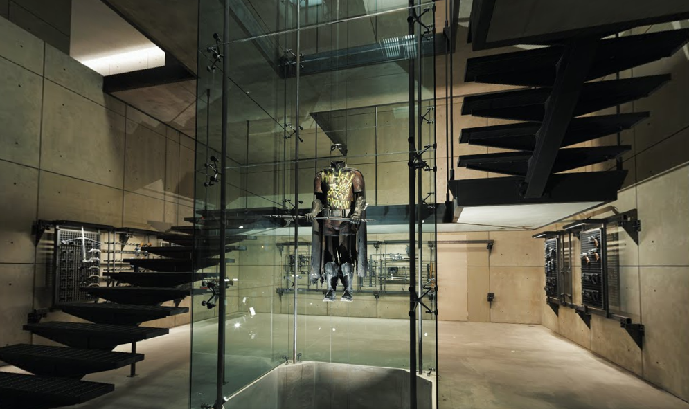 Robin's costume can be seen in a glass case in a room full of armoury