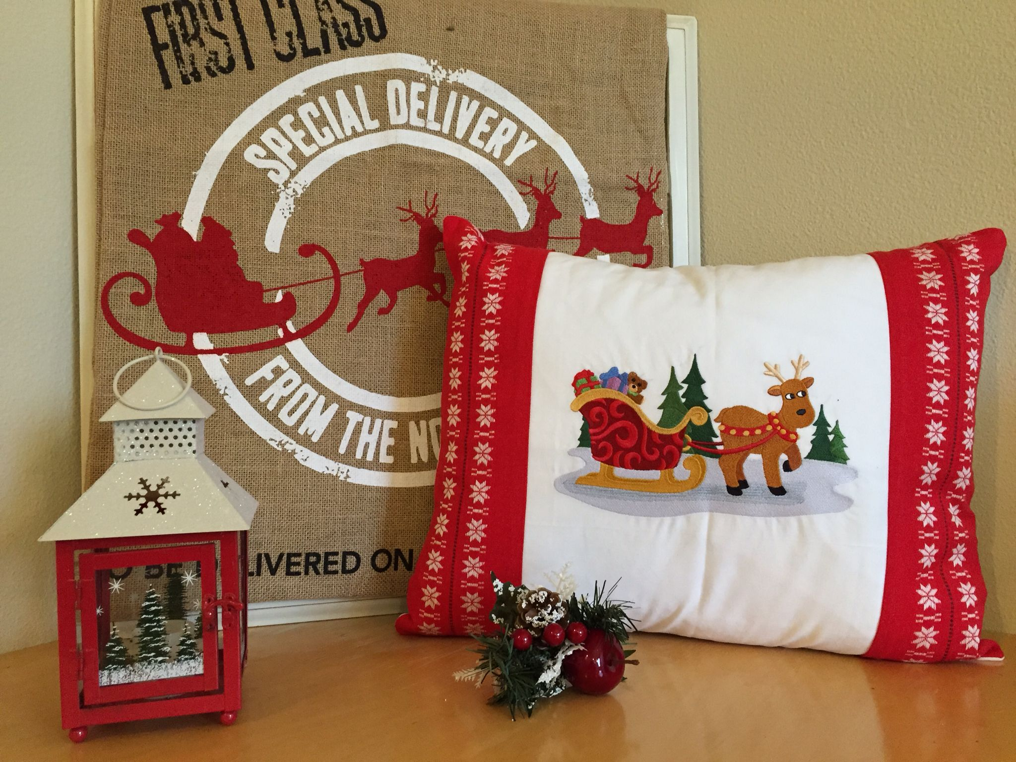 Darling Christmas Pillow made of vintage linens.  Embroidered Santa's Sleigh.  One of a kind Designer Pillow includes quality down/feather insert.  $133.00.  Use PIN10 Coupon Code for 10% off!  VintageStoryLinens at etsy.