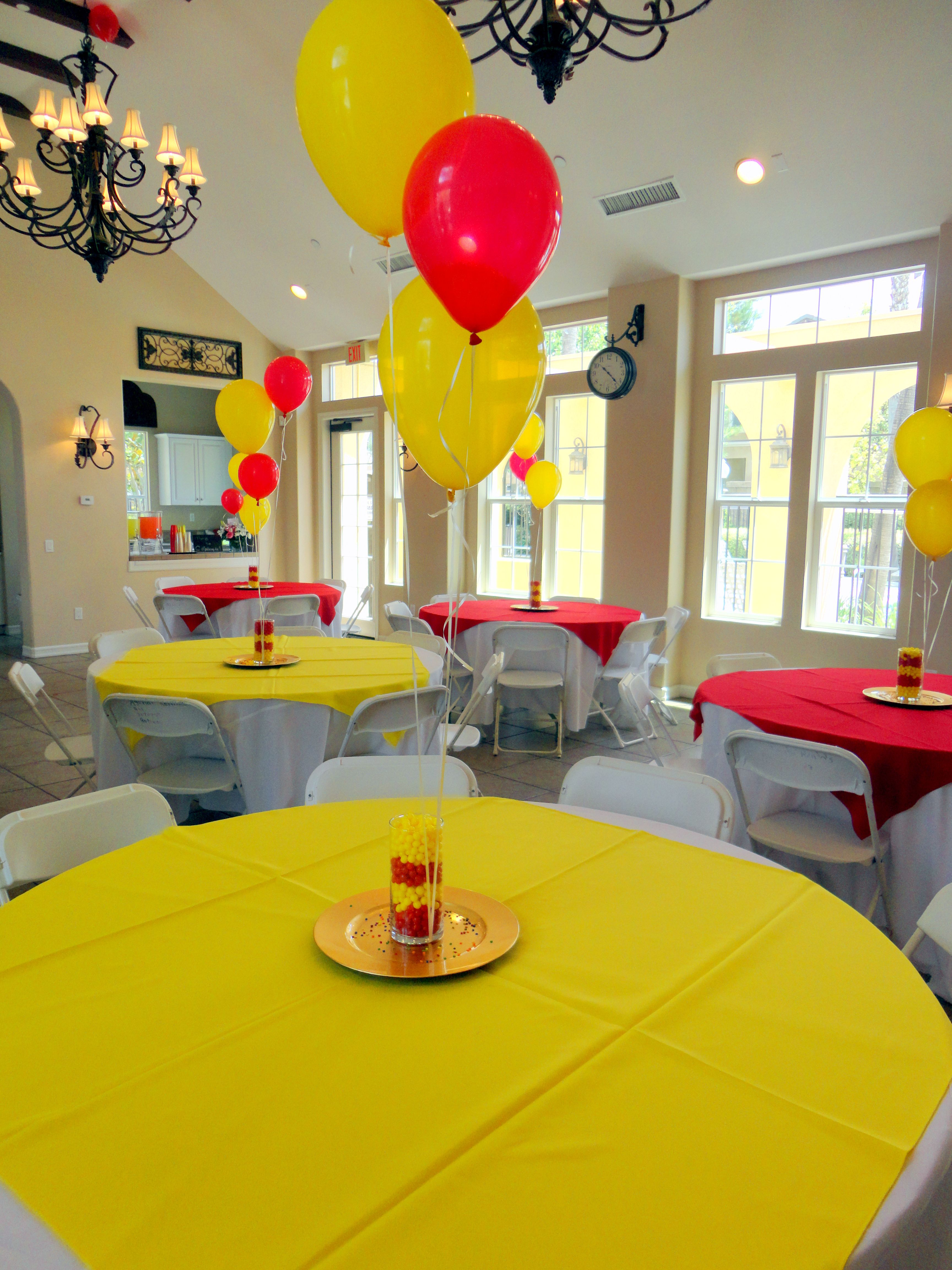 Alternated Red And Yellow Table Cloth Overlays Centerpieces Were
