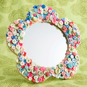 Button Framed Mirror. I did something like this in the kids new playroom; I (actually my mom :) just used a cheap rectangular mirror from Wal-Mart, turned out so cute!