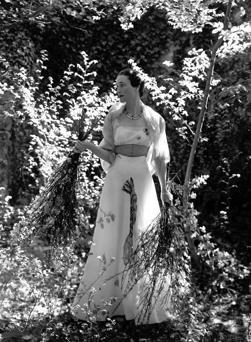 Vogue:  The Duchess of Windsor's Engagement Portrait-In the gardens of the Chteau de Cand, the Duchess of Windsor wears a chiffon dress by Schiaparelli with a hand-painted lobster on the front of the full skirt. Photo: Cecil Beaton, Vogue, October 1937