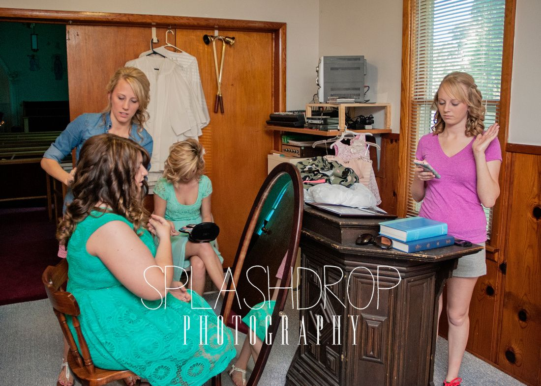 The Maid of Honor helping another bridesmaid with her hair while I have a diva bride moment...haha #splashdropphotography