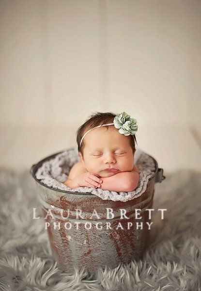 Baby posing buckets by laura brett of laura brett photography for bucket shots i always put a weight in the bottom of the bucket and have a parent next to