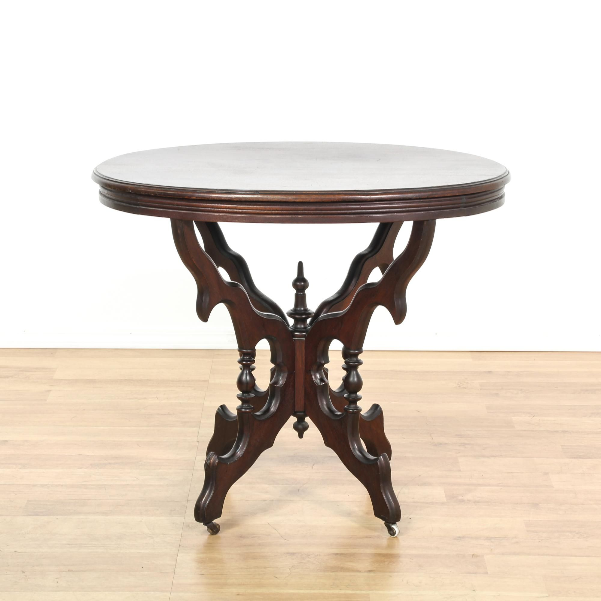 This coffee table is featured in a solid wood with a glossy mahogany