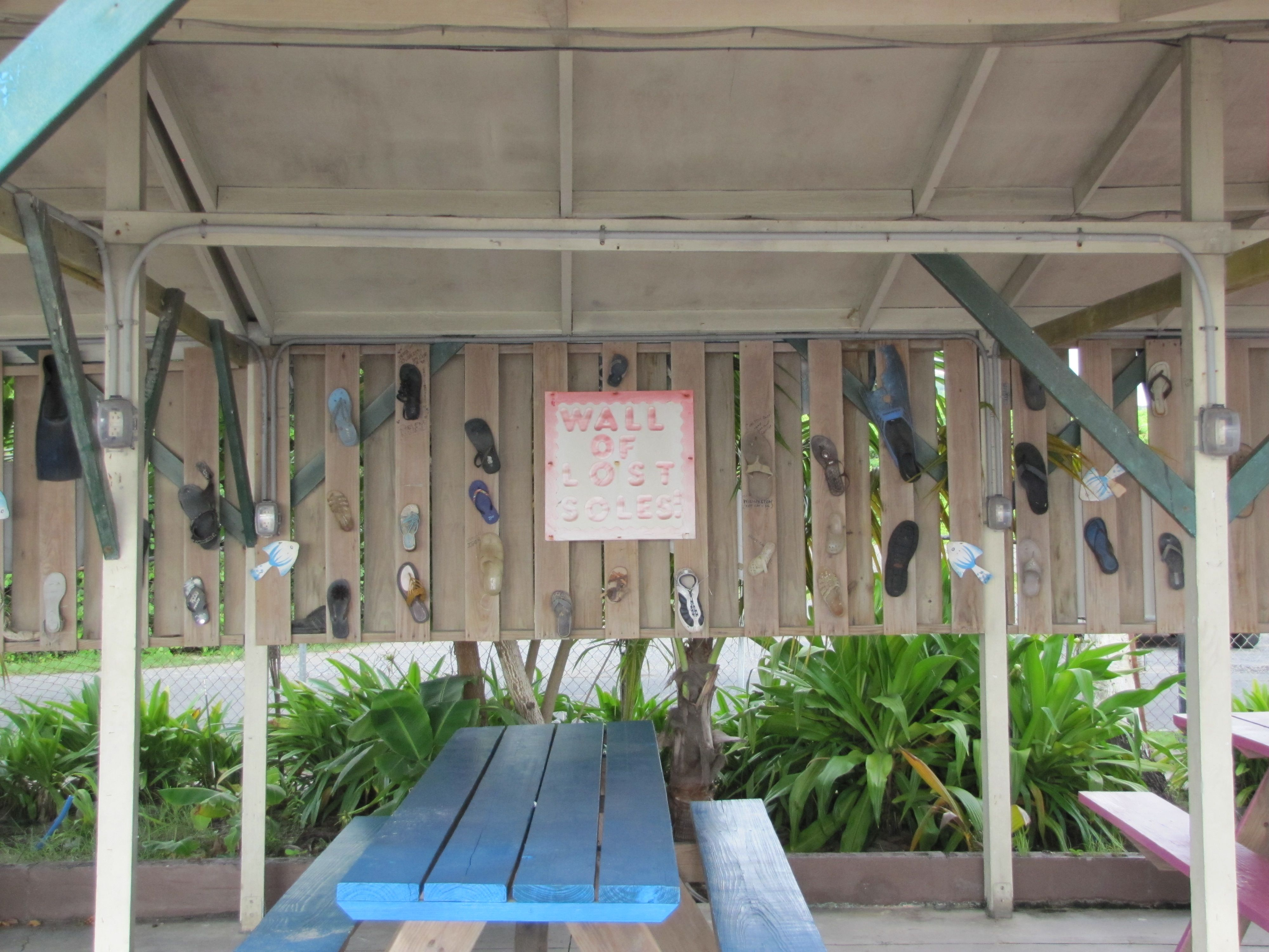 "The ""Wall of Lost Soles"" (single flippers, sandals and flipflops) left behind at Coconuts on the Beach, St. Croix."