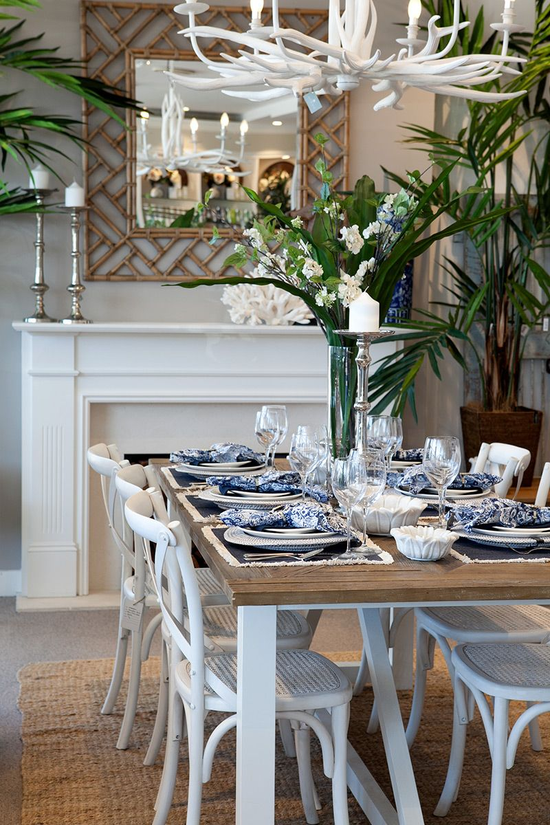 Hampton Inspired Dining Room With A Bamboo Mirror Elk Horn Chandelier White Hampton Chairs