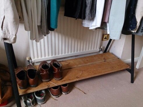 pretty basic little ikea hack using a turbo clothes rack and some old pine floorboards