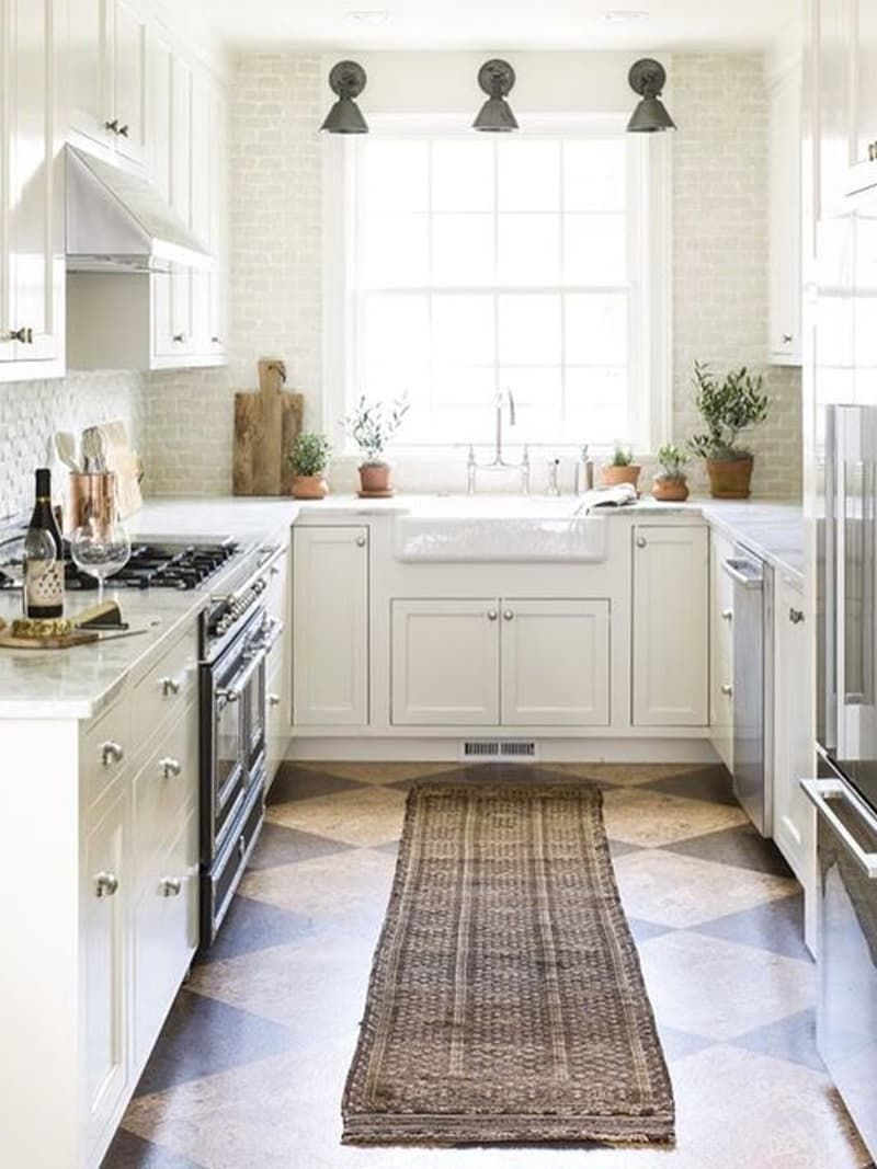 Looking for flooring ideas for your kitchen or bathroom remodel? Look no further than cork flooring! It's warm and natural and durable and beautiful to boot! This contrasting look with cork tiles from Habitat adds classic character to this kitchen.