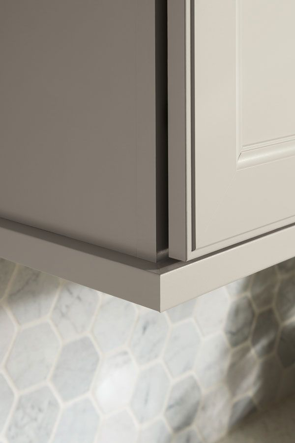 this handy trim moulding hides stacked cabinet seams puts the