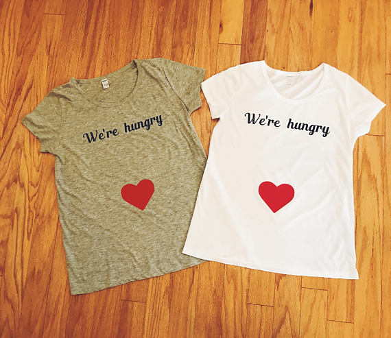 189cf604 Christmas Baby · Pregnancy Information · This We're Hungry graphic t-shirt  is a great way to highlight your