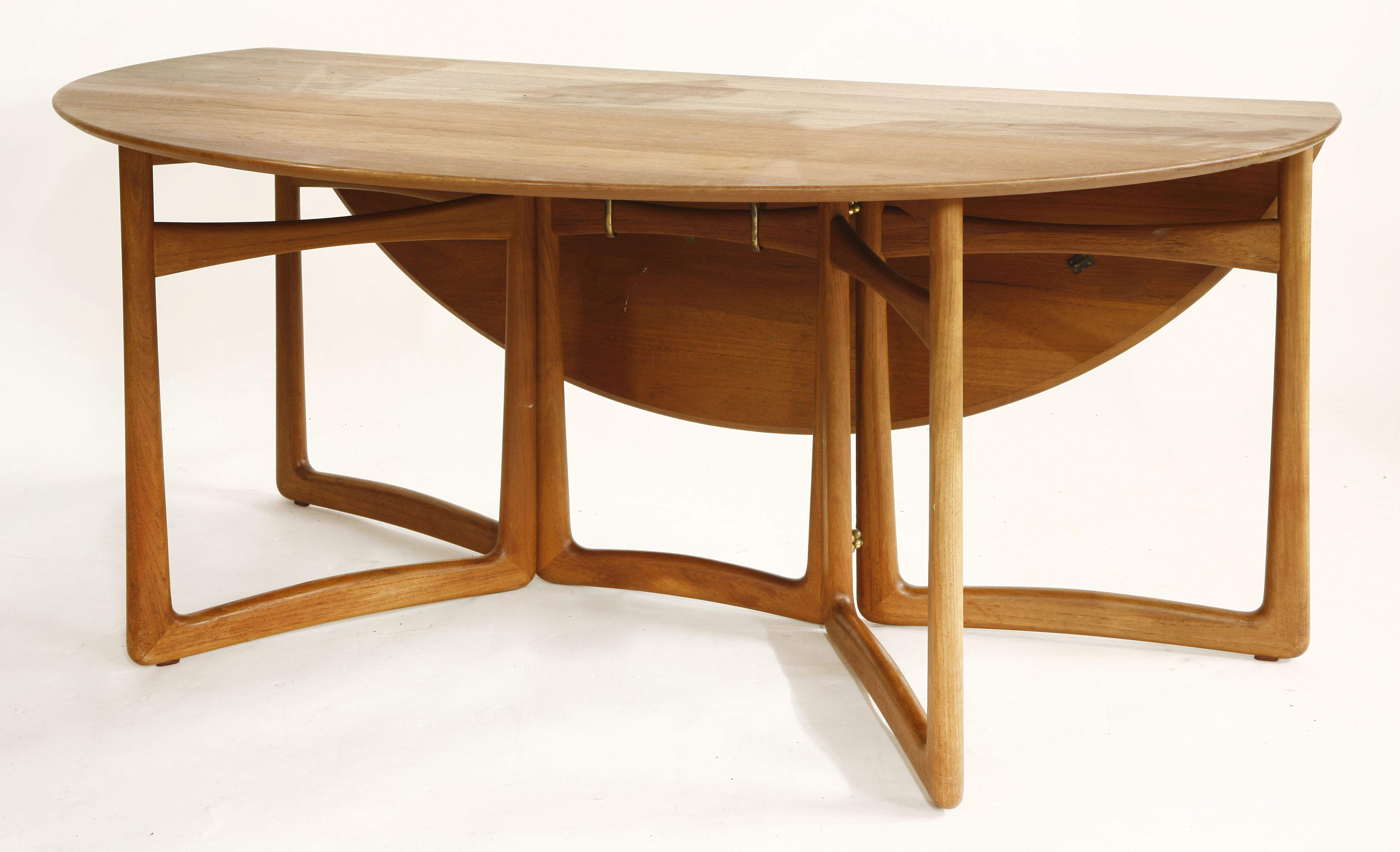 A teak circular drop-leaf dining table, c.1960, by Peter ...